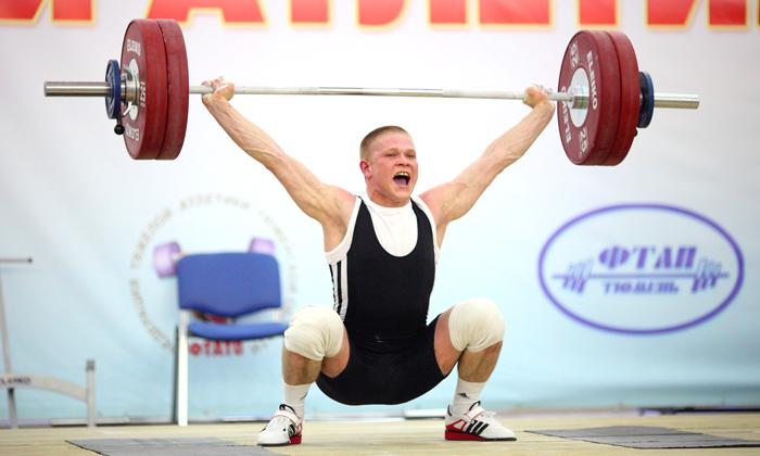 Появление геморроя может спровоцировать поднятие тяжестей например штанги